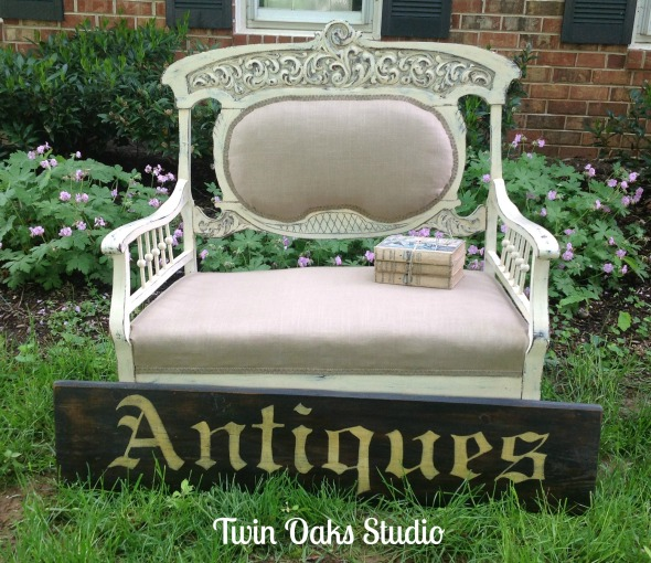 settee and sign